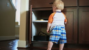 Baby Opening Cupboard stock video footage