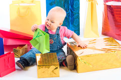 Baby opening gift Royalty Free Stock Photography