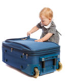 Baby opens suitcase royalty free stock images