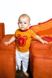 Baby in orange Stock Images