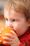 Baby and orange Royalty Free Stock Photography
