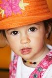 Baby with orange hat Stock Image