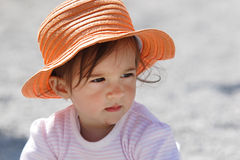 Baby with orange hat Stock Images