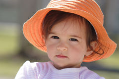 Baby with orange hat Royalty Free Stock Image