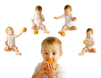 Baby with orange over white. Collection Royalty Free Stock Photo