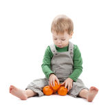 Baby with oranges Royalty Free Stock Photo