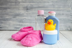 Baby organic cosmetic for bath on wooden bakground. Close up stock image