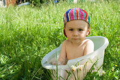 Baby in outdoor bath Stock Image
