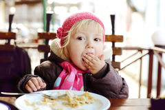 Baby in outdoor cafe Stock Images
