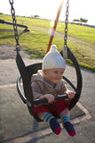 Baby in outdoor swing Stock Images