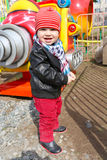 Baby outdoors in amusement park Stock Photo