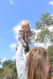Baby outdoors in summer with mom Royalty Free Stock Images