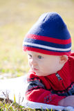 Baby Outside Looking to the Side Stock Photography