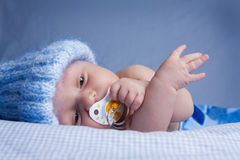 Baby with pacifier Stock Photography