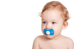 Baby with a pacifier. Serious baby with a pacifier in his mouth on a white background royalty free stock images