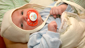 Baby with pacifier Stock Photos