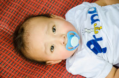 Baby with pacifier. Stock Images