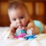 Baby and pacifier Stock Photos