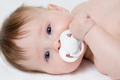 Baby with pacifier closeup stock photography