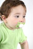 Baby with pacifier in mouth Stock Photos