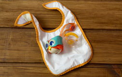 Baby Pacifier with Owl Container and Feeding Bib Royalty Free Stock Images