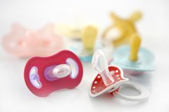 Baby pacifier set over white background Royalty Free Stock Photos