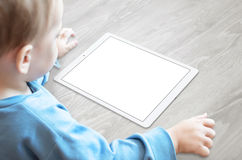 Baby with pacifier watching tablet with isolated screen for mockup Royalty Free Stock Photos