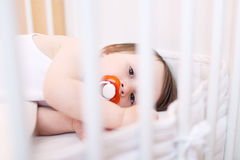 Baby with pacifier Stock Photo