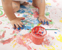 Baby and paint Stock Photo