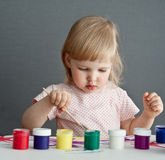 Baby with paint Stock Photo