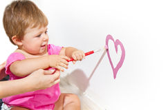 Baby  paint on a board Stock Images