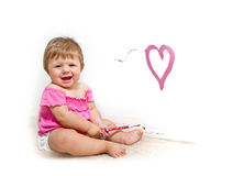 Baby  paint on a board Royalty Free Stock Images