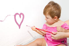 Baby  paint on a board Royalty Free Stock Image