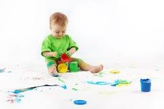 Baby painter Stock Image
