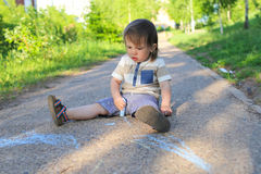 Baby painting with chalk in summer Stock Photography