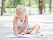 Baby painting Stock Photography