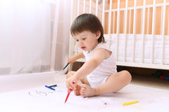 Baby painting with felt-pens at home Royalty Free Stock Photo