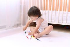 Baby painting with felt-pens Stock Photos
