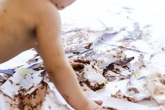 Baby painting with hands with chocolate Stock Photos