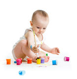 Baby painting by paintbrush - on white background Royalty Free Stock Image