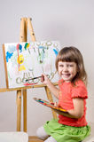 Baby paints Stock Photo