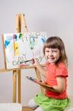 Baby paints Stock Photo