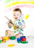 Baby and paints Royalty Free Stock Image