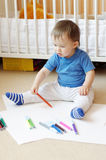 Baby paints at home Royalty Free Stock Images