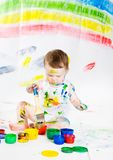 Baby and paints Royalty Free Stock Photos
