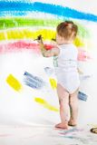 Baby and paints Royalty Free Stock Photography
