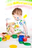 Baby and paints Stock Image