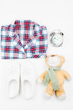 Baby pajamas and toy for good dreams, top view on a white. Background Royalty Free Stock Images