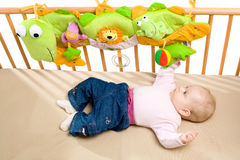 Baby palying on bed Royalty Free Stock Photos