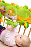 Baby palying on bed Stock Photo
